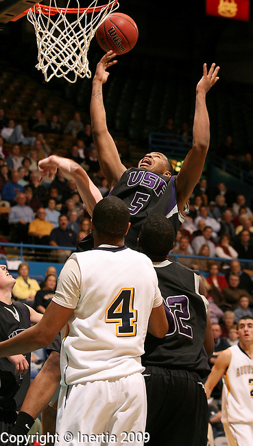 SIOUX FALLS, SD - NOVEMBER 18:  De'Shawn Howard #5 of the University of Sioux Falls pulls down a loose ball over Kenny Brown #4 of Augustana College in the first half of the 2009 Prairie Spirit Charitable Challenge Wednesday night at the Sioux Falls Arena. (Photo by Dave Eggen/Inertia)
