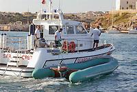 - motor patrol boat of Border Police recovers a rubber raft used by clandestine immigrants leaving from African coasts to land on Lampedusa island....- motovedetta della Guardia di Finanza recupera un gommone usato dagli immigrati clandestini che partono dalle coste africane per sbarcare sull'isola di Lampedusa