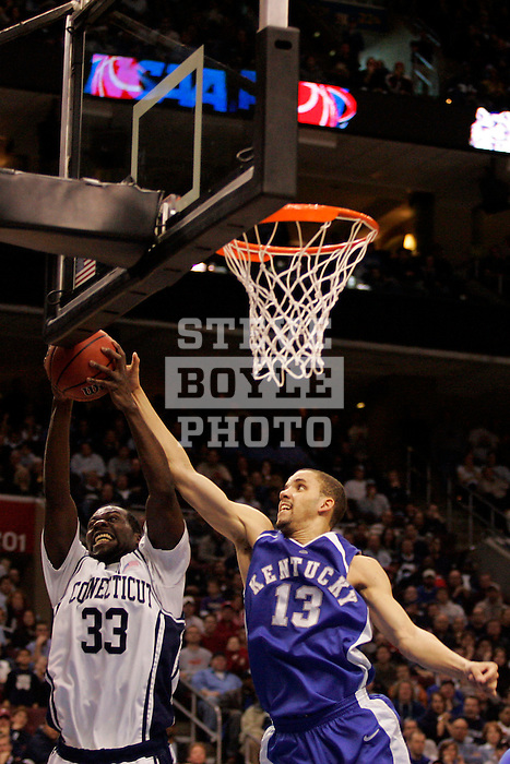 Connecticut forward Denham Brown (33) grabs a rebound in front of Kentucky forward Bobby Perry (13).  Connecticut defeated Kentucky 87-83 in the second round of the NCAA Tournament  at the Wachovia Center in Philadelphia, Pennsylvania on March 19, 2006.