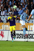 Thursday 08 August 2013<br /> Pictured L-R: Ashley Williams of Swansea gets a header against Miiko Albornoz of Malmo<br /> Re: Malmo FF v Swansea City FC, UEFA Europa League 3rd Qualifying Round, Second Leg, at the Swedbank Stadium, Malmo, Sweden.