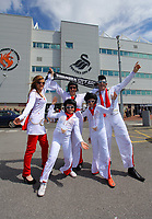 FAO SPORTS PICTURE DESK<br /> Pictured L-R: 13 year old Chloe Doyle with mum Lynette, dad Christopher, FRONT L-R sister Naomi 10 and brother Cameron 11, Swansea supporters dressed up as Elvis Presley, outside the Liberty Stadium at the request of manager Brendan Rodgers. Sunday, 13 May 2012<br /> Re: Premier League football, Swansea City FC v Liverpool FC at the Liberty Stadium, south Wales.