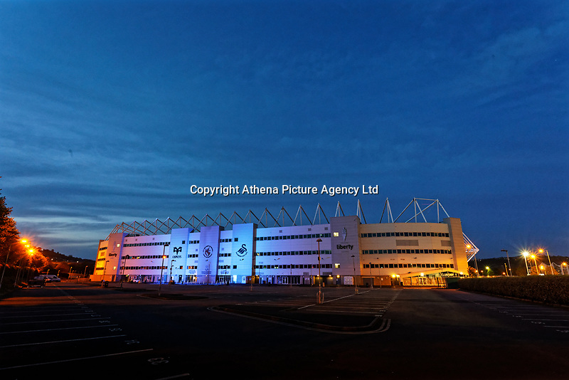 The Liberty Stadium is illuminated in blue, in support to the NHS and the fight against the Covid-19 Coronavirus pandemic, Swansea, Wales, UK.