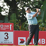 Angel Cabrera tees off at the third hole on Round 2 of the CIMB Asia Pacific Classic 2011.  Photo © Andy Jones / PSI for Carbon Worldwide