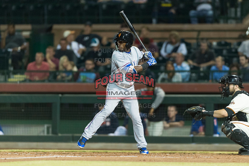 Surprise Saguaros left fielder Julio Pablo Martinez (40), of the Texas Rangers organization, at bat in front of catcher Matt Winn (16) during an Arizona Fall League game against the Scottsdale Scorpions at Scottsdale Stadium on October 15, 2018 in Scottsdale, Arizona. Surprise defeated Scottsdale 2-0. (Zachary Lucy/Four Seam Images)
