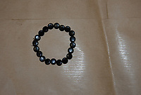 Pictured: The beaded bracelet worn by Royston Payne<br /> Re: The death of Royston Payne, whose body was found in Cynon River at Penrhiwceiber is being treated as unexplained according to police.<br /> Officers are trying to trace the last movements of the 46-year-old man from Aberaman, in Rhondda Cynon Taff.<br /> His body was discovered on 23 November in the middle of a very swollen river in Wales.<br /> The last confirmed sighting of Mr Payne was on 12 August in Aberaman and police are trying to trace his movements between those dates.<br /> South Wales Police Det Insp Richard Erskine said he wanted to build an accurate picture of his lifestyle and associates.