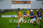 Ronan Walsh of Kilmoyley on a solo run as he out runs Lixnaws Aodhan Shanahan in round 2 of the County Senior hurling championship