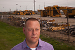 Denny Ryder was laid off from Caterpillar in late 2013, and left Decatur, his hometown, to work for a Caterpillar contractor in North Carolina. Ryder is shown during a return visit in front of Keen Transport across from the Caterpillar plant. Longtime industrial city Decatur, Ill., had the country's greatest unemployment rate reduction. But people leaving the workforce – moving away, retiring, no longer looking for jobs -- may be the cause, rather than economic expansion. <br /> CREDIT: Kristen Schmid for the Wall Street Journal<br /> RUSTBELT
