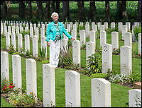 BNPS.co.uk (01202 558833)<br /> Pic: PhilYeomans/BNPS<br /> <br /> Dedication - Willemein Rieken at Trooper Edmunds grave at Arnhem.<br /> <br /> As the 75th anniversary of Operation Market Garden begins tomorrow, one of the original 'flower girl''s of Arnhem is still remembering...<br /> <br /> A heartwarming tale of dedication and rememberance has been revealed over a remarkable Dutch pensioner who still tends the grave of a fallen British Arnhem hero, 75 years after he perished in battle.<br /> <br /> Every year, Willemien Rieken (84) still lays flowers at Oosterbeek War Cemetery in memory of Trooper William Edmond, who was shot by a German sniper in the early stages of Operation Market Garden in 1944.<br /> <br /> Trp Edmond, of the elite 1st Airborne Reconnaissance Squadron's final words, uttered to two comrades who came to his aid, were 'tell my wife I love her'.<br /> <br /> Willemien was just nine years old when Oosterbeek became a bloody battleground in September 1944. The retired director's secretary, now aged 84, hid in a small cellar underneath her father's confectionary shop for five days while fierce fighting raged around their house and garden.<br /> <br /> Twenty-five of her family, friends and neighbours packed into the confined space and cowered in fear in the deafening din of shooting and explosions.<br /> <br /> After the war the grateful citizens of Arnhem arranged a poignant ceremony involving a nine year old Willimein and other school children from the town, to lay flowers at the graves of the British soldiers killed in the battle. <br /> <br /> And the dedicated pensioner is now one of the last survivors to still undertake the task.