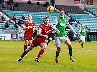 6th February 2021; Easter Road, Edinburgh, Scotland; Scottish Premiership Football, Hibernian versus Aberdeen; Jonathan Hayes of Aberdeen and Jackson Irvine of Hibernian compete for possession of the ball