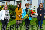 Irene O'Keeffe is presented flowers at her retirement as Principal of Coolick NS Kilcummin on Thursday l-r: Ciara Irwin Foley Chairperson Board of Management, Tara  O'Donoghue  staff member Erica Dick Parents Association