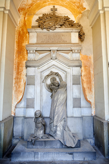 Picture and image  of the stone sculpture of a child being lifted to kiss the deceased.  The Casella tomb sculptor G Benetti 1884. monumental tombs of the Staglieno Monumental Cemetery, Genoa, Italy