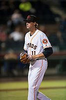 Scottsdale Scorpions starting pitcher Forrest Whitley (11), of the Houston Astros organization, walks off the field between innings of an Arizona Fall League game against the Mesa Solar Sox on October 9, 2018 at Scottsdale Stadium in Scottsdale, Arizona. The Solar Sox defeated the Scorpions 4-3. (Zachary Lucy/Four Seam Images)