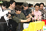 "May 3, 2010 - Tokyo, Japan - Visitors take pictures of PVC Figurines on display during the Treasure Festa 2010 at Tokyo Big Sight, Japan, on May 4, 2010. Some visitors and hobbyists concentrate specifically on a certain type of figure, such as garage kits, gashapon, or PVC bishojo (pretty girl) statues. According to many who study the phenomenon, many 'figure moe zoku', a Japanese term which refers to ""Otaku who collect figurines"", have difficulty in navigating modern romantic life and prefer to go on ""dates"" with their favorite figurine during off hours."