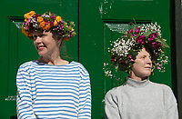 BNPS.co.uk (01202 558833)<br /> Pic: ZacharyCulpin/BNPS<br /> <br /> Pictured: Londoners celebrate Garden Day by making flower crowns in the gardens of St George the Martyr church in Southwark.  <br /> <br /> Garden Day is back for a third successive year on Sunday, 9th May 2021 to celebrate outdoor and indoor garden spaces. The nationwide movement is called on plant-lovers to make a flower crown, and share their plant spaces with family and<br /> friends