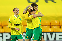 6th April 2021; Carrow Road, Norwich, Norfolk, England, English Football League Championship Football, Norwich versus Huddersfield Town; Jordan Hugill of Norwich City celebrates his goal with Max Aaron for 7-0 in the 78th minute