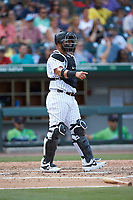 Charlotte Knights catcher Wellington Castillo (25) on defense against the Gwinnett Braves at BB&T BallPark on July 14, 2019 in Charlotte, North Carolina.  The Stripers defeated the Knights 5-4. (Brian Westerholt/Four Seam Images)