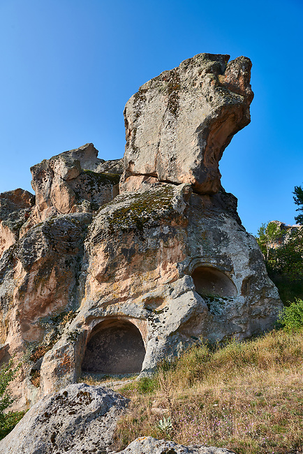 Phrygian tombs cut into rock formations  protecting the citadel of Midas . From the 8th century BC . Midas City, Yazilikaya, Eskisehir, Turkey.<br /> <br /> The earliest Phrygian settlement here began in the last quarter of the 8th century BC. Even after the Phrygian kingdom collapsed politically, the city was not abandoned and the Phrygian rock structures and tombs were conserved, with some additions and changes made.in the Persian, Hellenistic, Roman and Byzantine periods.