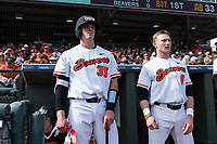 Oregon State Beavers catcher Adley Rutschman (35) and Andy Armstrong (9) during a game against the New Mexico Lobos on February 15, 2019 at Surprise Stadium in Surprise, Arizona. Oregon State defeated New Mexico 6-5. (Zachary Lucy/Four Seam Images via AP)