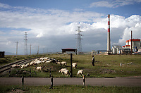 CHINA. A herder with his sheep in Xihai Township, or 'Atomic City'. It was the place where China's first atomic bomb was made and tested, on the Qinghai-Tibet Plateau in western China. 2010