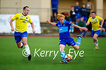 Classic's Paul Barrett forces Shane Houlihan of Dingle Bay Rovers  to shoot early in the Denny KDL Challenge Cup