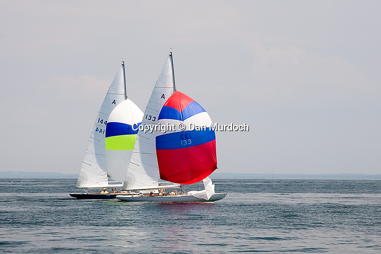 Two Atlantic sailboats racing on a calm day with spinnakers set