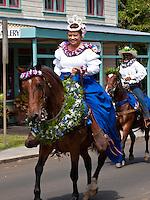 Pau riders on horseback in King Kamehameha Day Parade, North Kohala, Big Island of Hawaii, Kapa'au Town.