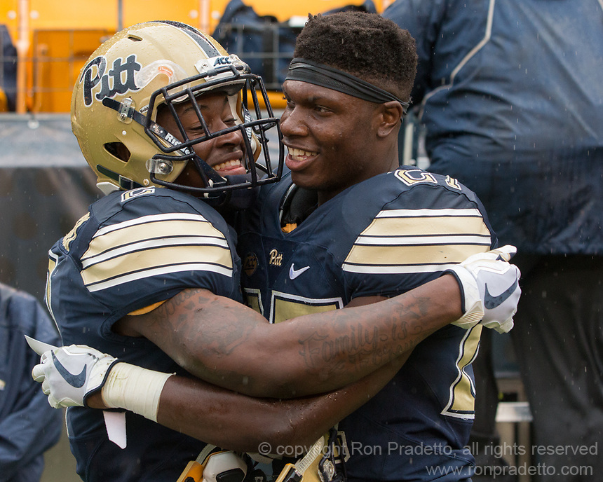 Maurice Ffrench (left) and Bricen Garner celebrate the win. The Pitt Panthers defeated the Youngstown State Penguins 28-21 in overtime at Heinz Field, Pittsburgh, Pennsylvania on September 02, 2017.