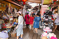 George Town, Penang, Malaysia.  Visitors at Souvenir Stands at Chew Jetty, a Historic Chinese Settlement.