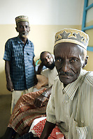 Djibouti. Tadjourah province. Tadjourah. Centre médico hospitalier (CMH). Hospital. Three black muslim men seated on a bed. The one in the center is suffering from HIV Aids and tuberculosis. The Global Fund through the djiboutian Ministry of Health supports the hospital with an Aids grant (financial aid).  © 2006 Didier Ruef