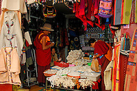 Tibetan Buddhist monks buying goods at a market stall in Barkhor Square, Lhasa, Tibet.