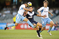MELBOURNE, AUSTRALIA - FEBRUARY 18, 2010: Nik Mrdja from Melbourne Victory and Simon Colosimo from Sydney FC head the ball in the first leg of the A-League Major Semi Final match between the Melbourne Victory and Sydney FC at Etihad Stadium on February 18, 2010 in Melbourne, Australia. Photo Sydney Low www.syd-low.com
