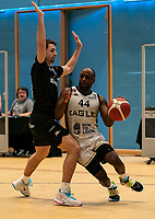 Rahmon Fletcher of Newcastle Eagles under pressure from Evan Walshe of Surrey Scorchers during the BBL Championship match between Surrey Scorchers and Newcastle Eagles at Surrey Sports Park, Guildford, England on 20 March 2021. Photo by Liam McAvoy.