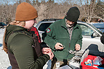 Selecting lag bands to be used on 3 captured Eastern wild turkey in Hampden, Maine.