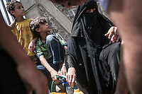 Monday 06 July, 2015: Civilians queue for water in Hajjah city up to the mountains at northwest of Yemen. (Photo/Narciso Contreras)