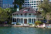 Ft. Lauderdale, Florida. Stranahan House, Built 1901, now a Museum, Surrounded by Modern Office Buildings in Downtown Ft. Lauderdale.