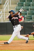 Courtney Hawkins (12) of the Kannapolis Intimidators follows through on his swing against the West Virginia Power at CMC-Northeast Stadium on August 17, 2012 in Kannapolis, North Carolina.  (Brian Westerholt/Four Seam Images)