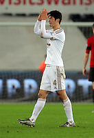 Goal scorer Ki Sung Yueng thanks home supporters after the Barclays Premier League match between Swansea City and West Bromwich Albion played at the Liberty Stadium, Swansea on December 26 2015