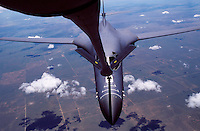 Aerial view of a United States B-1 bomber refueling in flight.