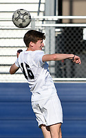 NWA Democrat-Gazette/CHARLIE KAIJO Bentonville High School Wyeth Mckean (16) heads the ball during a soccer game, Friday, April 26, 2019 at  Whitey Smith Stadium at Rogers High School in Rogers.