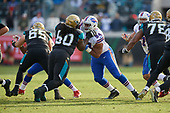 Buffalo Bills Rickey Hatley (94) rushes against A.J. Cann (60) during an NFL Wild-Card football game against the Jacksonville Jaguars, Sunday, January 7, 2018, in Jacksonville, Fla.  (Mike Janes Photography)