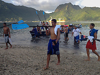 During a recent visit to American Samoa, I was invited along for a 14 mile round trip ride on this long boat out of Pago Pago Harbor. This 44 man boat belongs to Samoan High School, the only high school to have a boat.  Other boats are owned and crewed by local villages.  They are training for the annual Flag Day race on April 17th.  This was the end of training for the day.  Taken with an iPhone 4s.