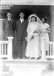 ALLEN WEDDING PARTY. Luther and Ida Allen are pictured at 828 B Street on their wedding day (around 1912). Luther Allen (1885-1969) was prominent in Lincoln's Prince Hall Masons. He was among black leaders from Omaha and Lincoln who met with Gov. Arthur Weaver in 1929 to quell tensions after a severe racial incident in North Platte. Luther was a longtime chauffeur for H. E. Gooch, who published the Lincoln Star newspaper and founded Gooch Mills. Ida Allen (1887-1983) was the daughter of Rev. George Maston, with whom they shared 828 B Street. She worked as a maid at the Miller and Paine store. When photographer John Johnson died in 1953, Ida helped distribute his photographs among the families portrayed.<br /> <br /> Photographs taken on black and white glass negatives by African American photographer(s) John Johnson and Earl McWilliams from 1910 to 1925 in Lincoln, Nebraska. Douglas Keister has 280 5x7 glass negatives taken by these photographers. Larger scans available on request.