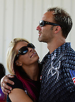 Sept. 23, 2012; Ennis, TX, USA: NHRA pro stock motorcycle rider Matt Smith (right) with wife Angie Smith during the Fall Nationals at the Texas Motorplex. Mandatory Credit: Mark J. Rebilas-US PRESSWIRE