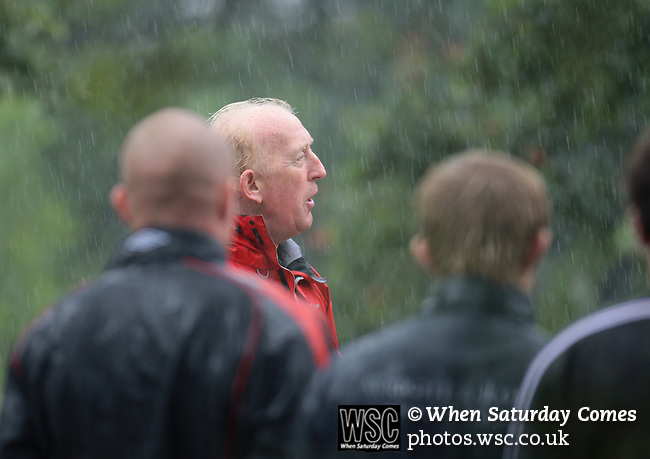 Mark Lillis, assistant manager of Morecambe Football Club talking to players in the rain at the end of a pre-season training run on Clougha Pike, Lancashire. The squad was preparing for the club's first-ever season in the Football League having been promoted from the Conference the previous season.  Photo by Colin McPherson.