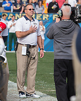 Pitt head coach Pat Narduzzi stands at attention for the playing of our National Anthem. The Miami Hurricanes football team defeated the Pitt Panthers 29-24 on  Friday, November 27, 2015 at Heinz Field, Pittsburgh, Pennsylvania.