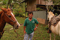 A gentleman with his horses in Costa Rica.