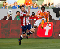 CARSON, CA - March 11, 2012: Chivas USA defender Heath Pearce (3) and Houston Dynamo defender Corey Ashe (26) during the Chivas USA vs Houston Dynamo match at the Home Depot Center in Carson, California. Final score Houston Dynamo 1, Chivas USA 0.