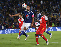 BOGOTÁ - COLOMBIA, 11-11-2018:Andres Cadavid  (Izq.) jugador de Millonarios disputa el balón con Carmelo Valencia (Der.) jugador del Independiente Santa Fe durante partido por la fecha 19 de la Liga Águila II 2018 jugado en el estadio Nemesio Camacho El Campín de la ciudad de Bogotá. /Andres Cadavid (L) player of Millonarios  fights for the ball with Carmelo Valencia (R) player of Independiente Santa Fe during the match for the date 19 of the Liga Aguila II 2018 played at the Nemesio Camacho El Campin Stadium in Bogota city. Photo: VizzorImage / Felipe Caicedo / Staff.