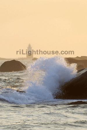 Waves crash on shore near the Sakonnet Point Lighthouse.