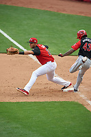 Team USA first baseman Matt Olson (21) stretches for a throw as Raul Adalberto Mondesi (43) runs through the bag during the MLB All-Star Futures Game on July 12, 2015 at Great American Ball Park in Cincinnati, Ohio.  (Mike Janes/Four Seam Images)